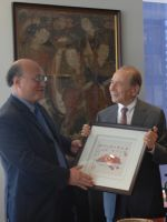 Colin Wu, Executive Vice Chairman of USCN Presenting a Limited Print of Huang Yongyu's Work to Maurcie Greenberg