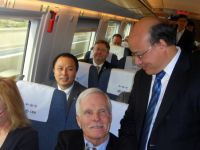 Colin Wu with Ted Turner aboard the hi-speed train to the forum in Tianjin